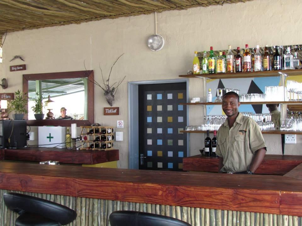 Namibia Etosha Mopane Village Lodge Bar Iwanowskis Reisen - afrika.de