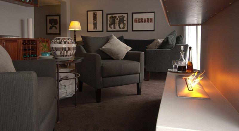 Südafrika De Kelders Cliff Lodge Lounge Iwanowskis Reisen - afrika.de