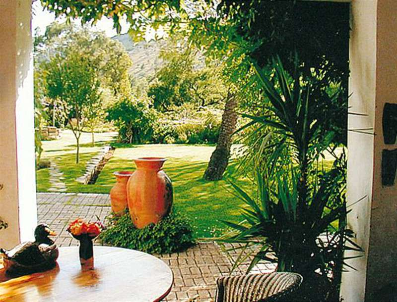 Südafrika Smithfield Pula House Garten Iwanowskis Reisen - afrika.de