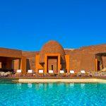 Namibia Kaokoland Okahirongo Elephant Lodge Pool Iwanowskis Reisen - afrika.de